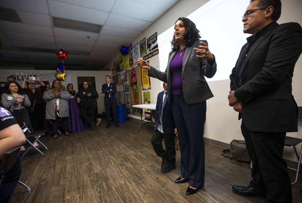 Former assemblywoman Olivia Diaz, a Las Vegas City Council candidate for Ward 3, center right, ...