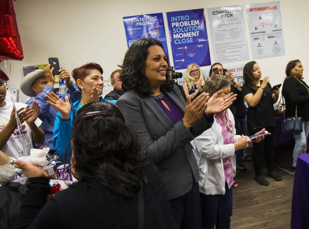 Former assemblywoman Olivia Diaz, a Las Vegas City Council candidate for Ward 3, center, claps ...