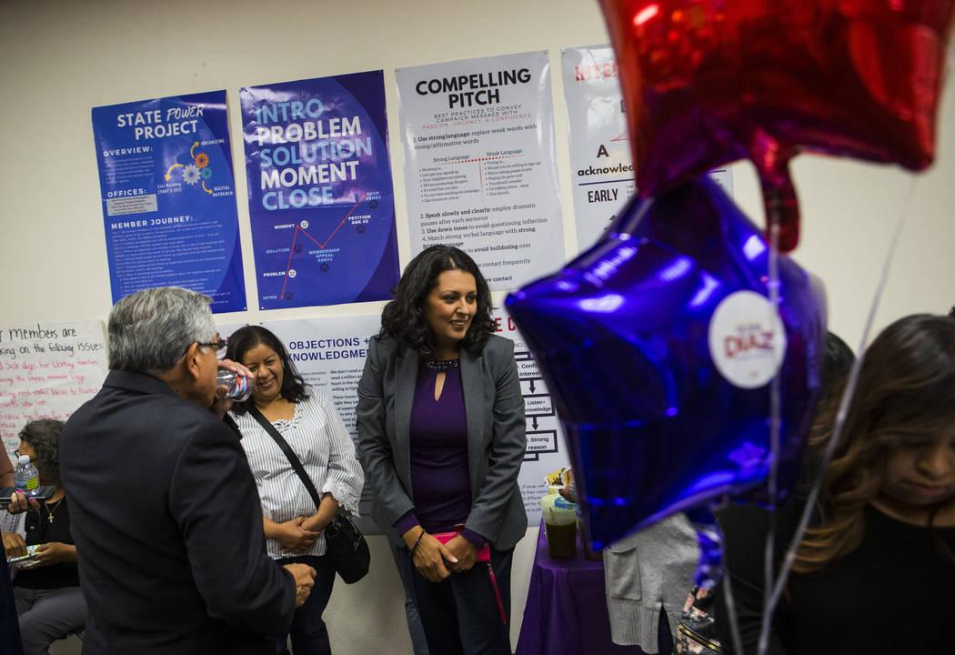 Former assemblywoman Olivia Diaz, a Las Vegas City Council candidate for Ward 3, center, talks ...