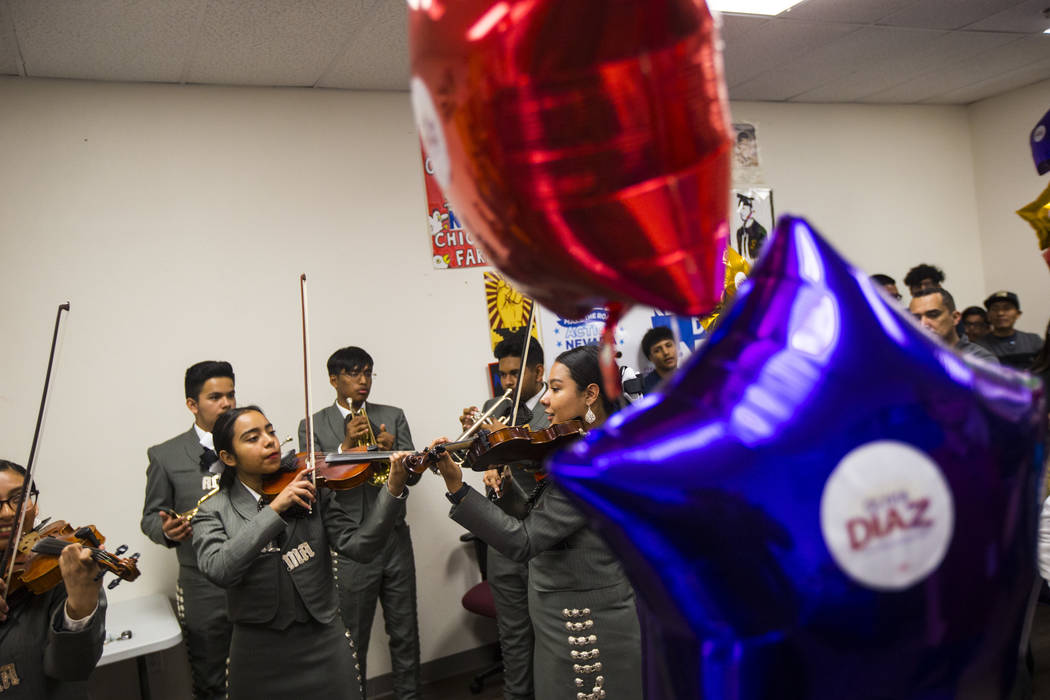 Members of Mariachi Alma del Canon, out of Canyon Springs High School, perform during an electi ...