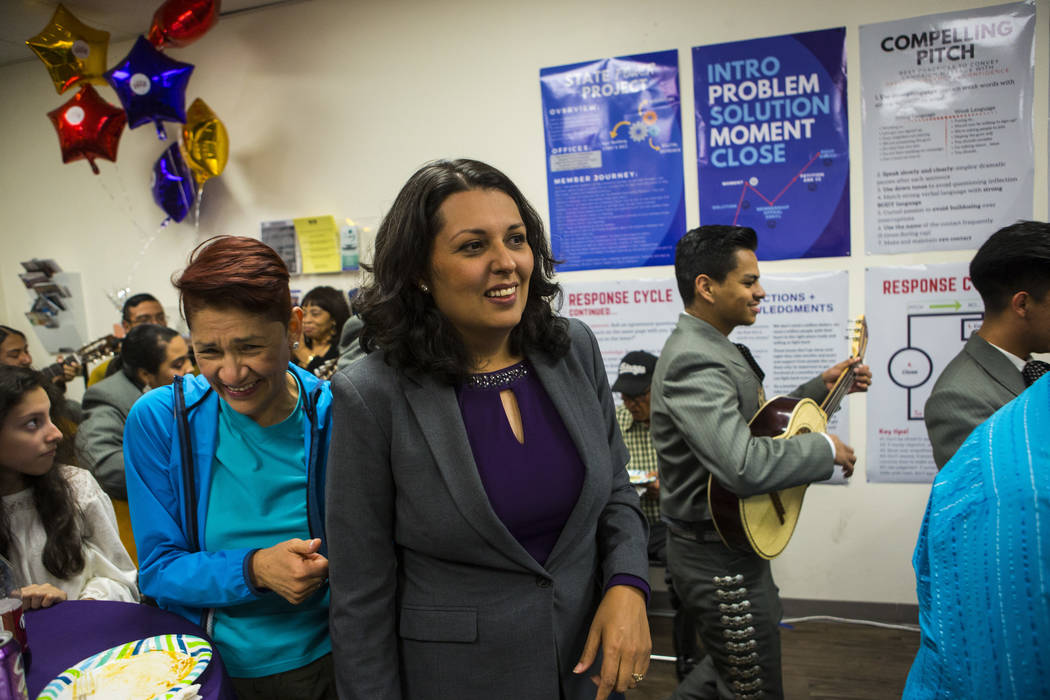 Former assemblywoman Olivia Diaz, a Las Vegas City Council candidate for Ward 3, center, visits ...