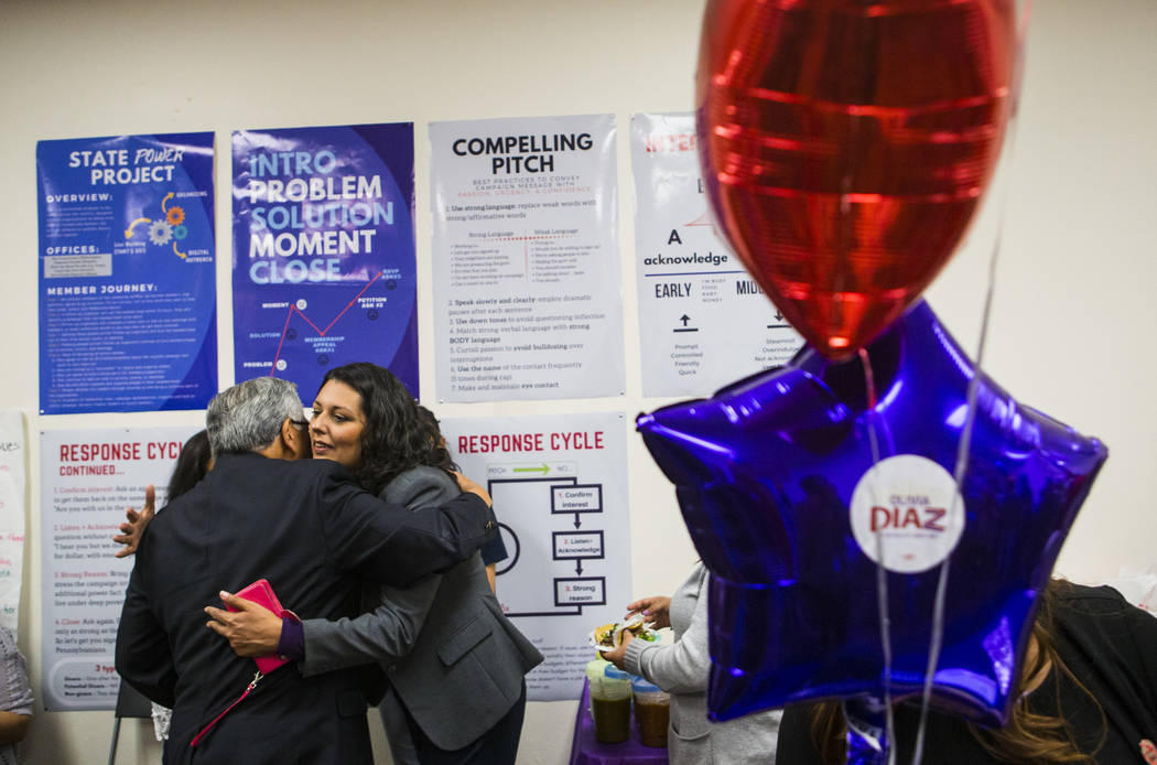 Fernando Romero, president of Hispanics in Politics, left, hugs former assemblywoman Olivia Dia ...