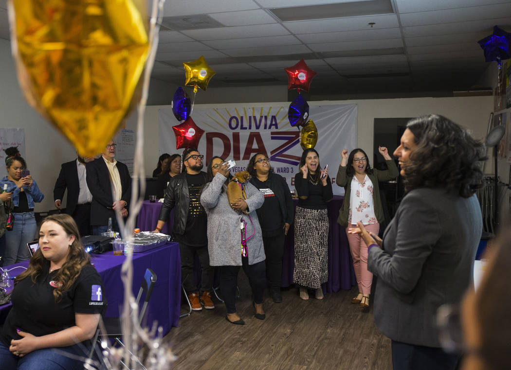Supporters of former assemblywoman Olivia Diaz, a Las Vegas City Council candidate, reacts as r ...