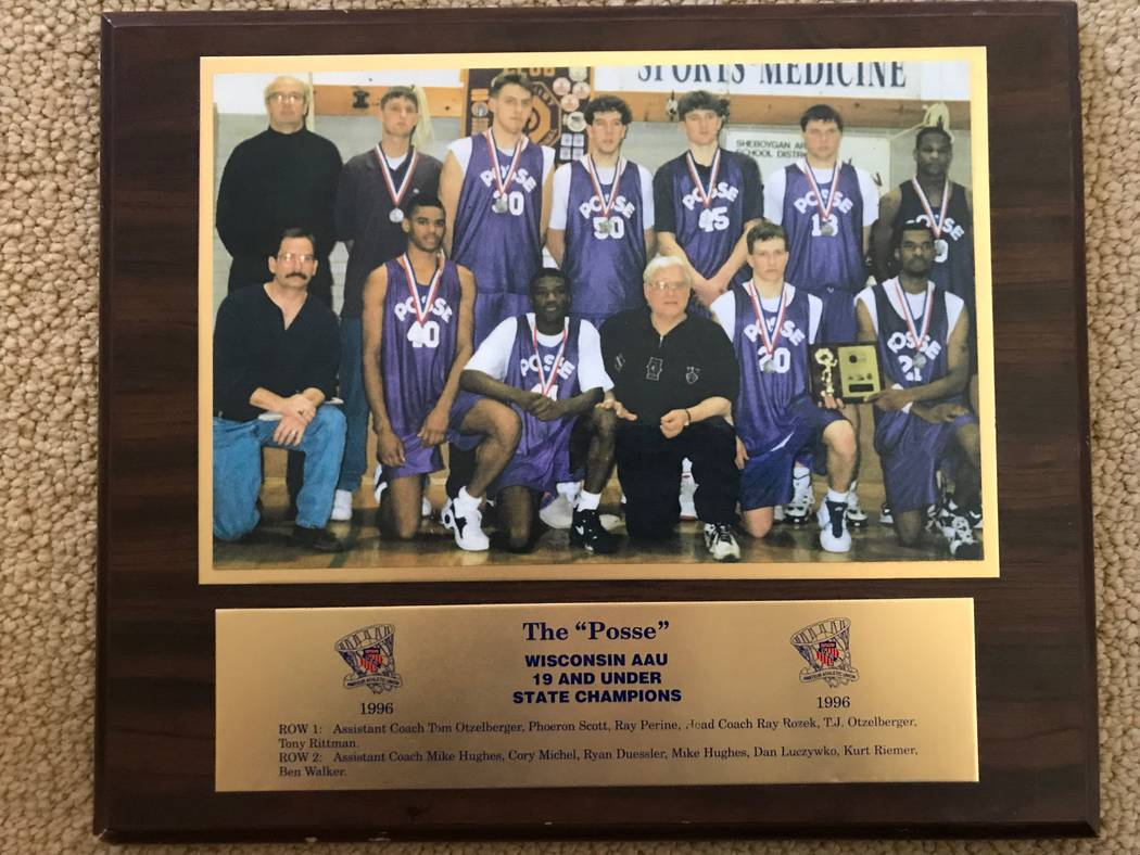 New UNLV coach T.J. Otzelberger poses with the Milwaukee AAU team he created in the 1990s. He i ...