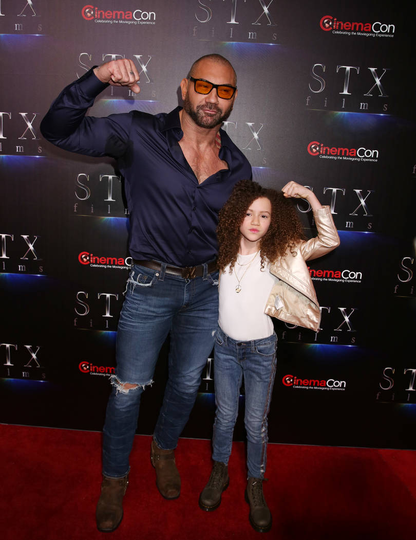 Actors Dave Bautista, left, and Chloe Coleman from MySpy arrive at CinemaCon red carpet at The ...
