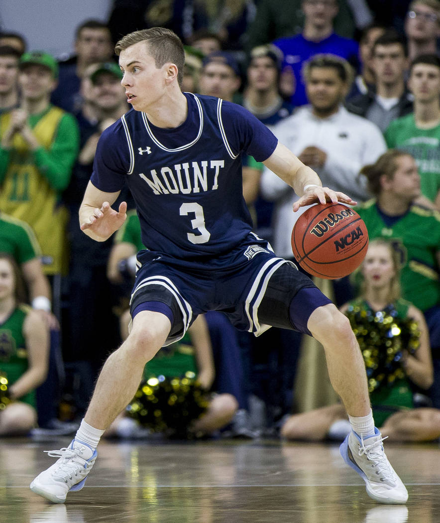Mount St. Mary's Jonah Antonio (3) moves the ball around the perimeter during the first half of ...
