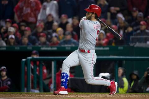 Philadelphia Phillies' Bryce Harper watches his double during the fifth inning of a baseball ga ...