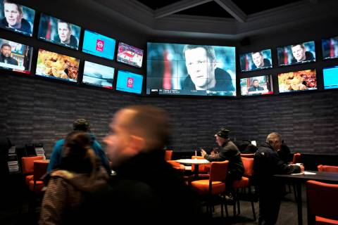Patrons visit the sports betting area of Twin River Casino in Lincoln, R.I., on Jan. 28, 2019. ...