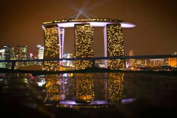 A reflection of Marina Bay Sands Singapore from a table at Gardens by the Bay, Dec. 13, 2012. T ...