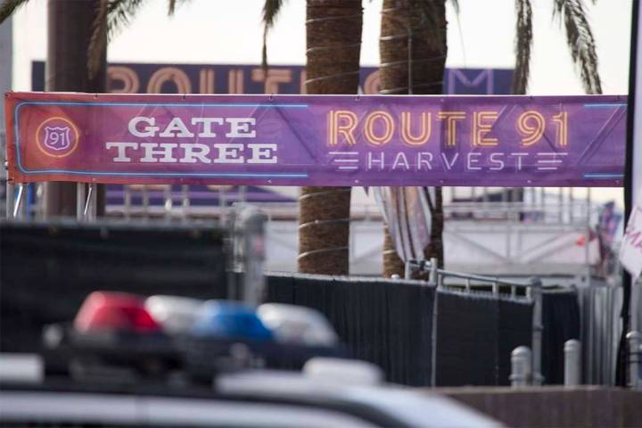 Police keep guard at the site of the Route 91 Harvest country music festival at the Las Vegas V ...