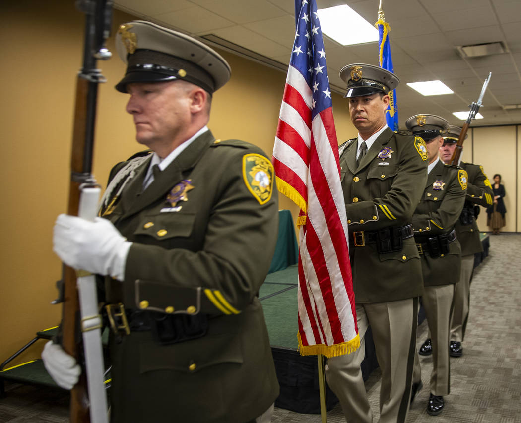 The Metropolitan Police Department honor guard marches with the colors opening a commendation c ...