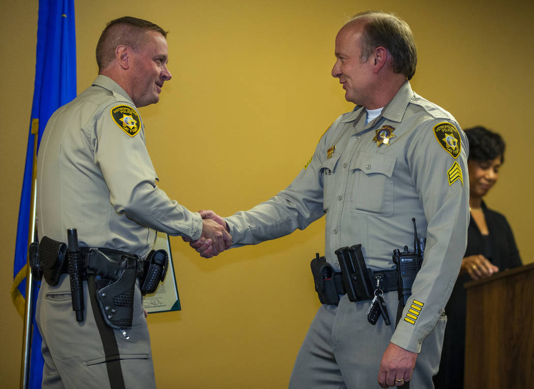 Undersheriff Kevin McMahill shakes the hand of Sgt. Paul McCullough, receiving a unit exemplary ...