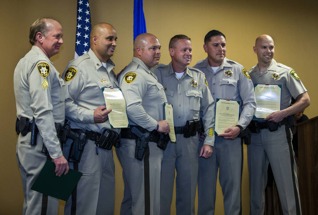 Collision investigative team officers receiving a unit exemplary award stand with Undersheriff ...