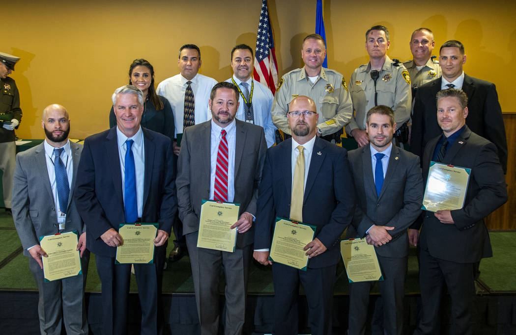 """Members of the """"1 October ballistics team"""" receive a unit exemplary award from Undersheriff Kev ..."""