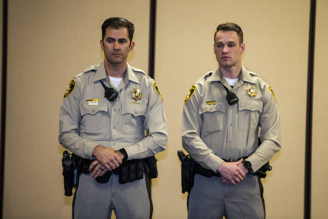 Officers Dennis Moyer and Kevin Moss ready to receive a lifesaving award during a Metropolitan ...