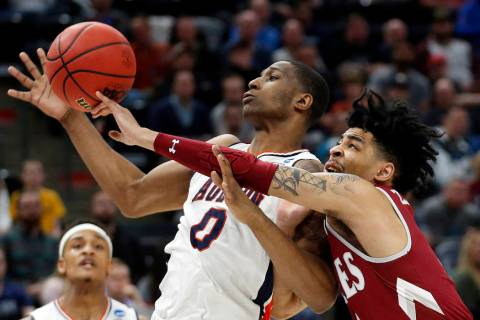 Auburn's forward Horace Spencer (0) and New Mexico State guard JoJo Zamora (4) battle for a reb ...