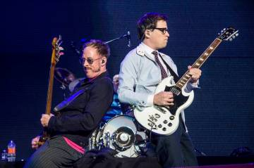 Scott Shriner, left, and Rivers Cuomo of Weezer perform at the 2017 KROQ Almost Acoustic Christ ...