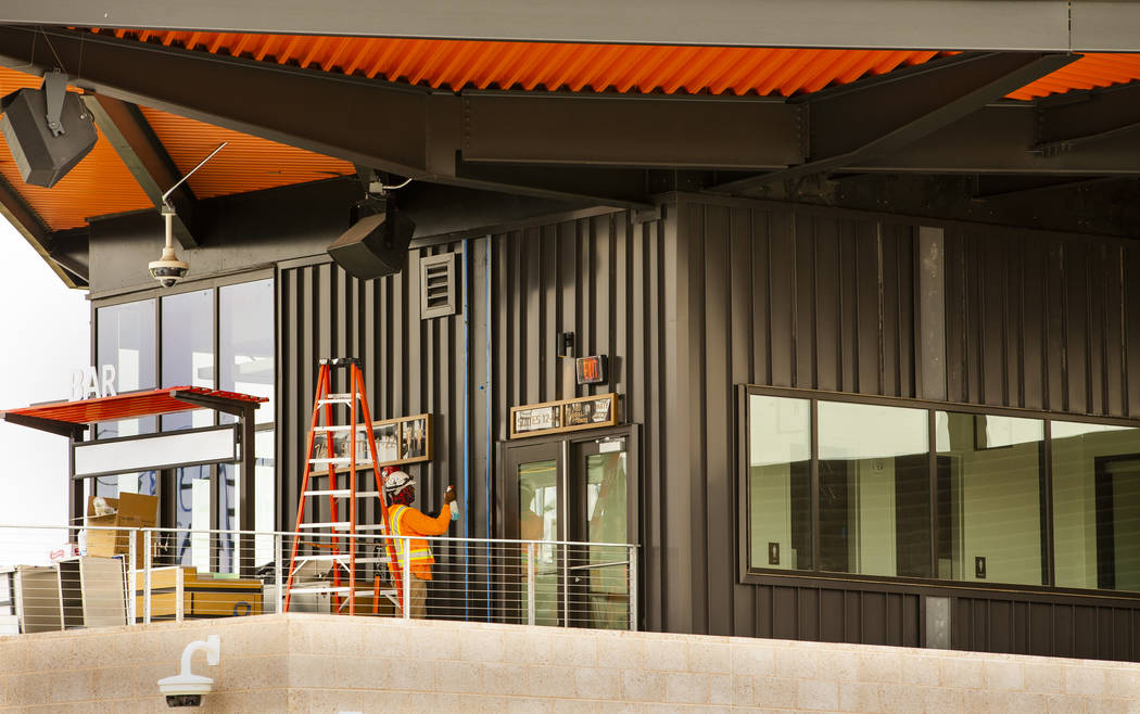 Crews complete finishing touches on the exterior of the Las Vegas Ballpark on Monday, April 8, ...