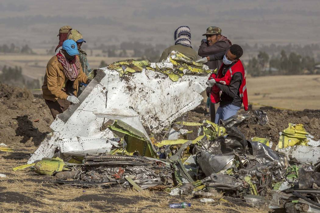 FILE - In this March 11, 2019, file photo, rescuers work at the scene of an Ethiopian Airlines ...