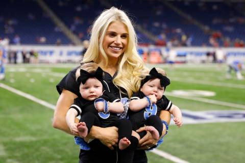 Kelly Stafford, wife of Detroit Lions quarterback Matthew Stafford holds the couple's twins Saw ...