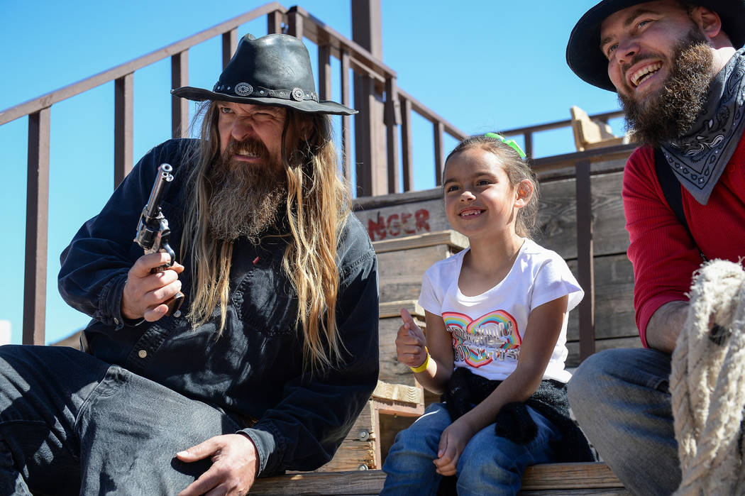 Ellie Mendoza, 7, from Las Vegas, middle, poses for a photograph with Jesse Reeder, left, and M ...