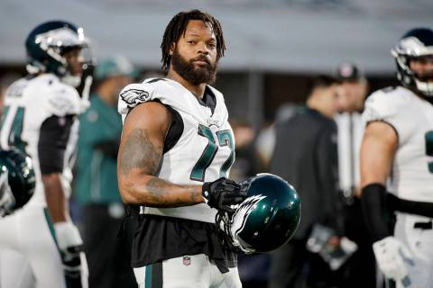 Philadelphia Eagles defensive end Michael Bennett warms up before an NFL football game against ...