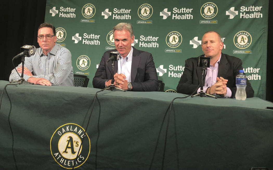 From left, Oakland Athletics manager Bob Melvin, executive vice president of baseball operation ...