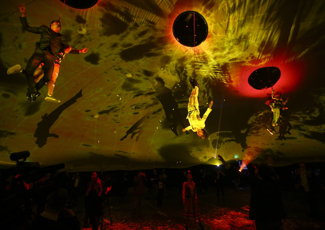 """Cast members in """"Fuerza Bruta"""" perform as part of a media preview at the show's tent ..."""