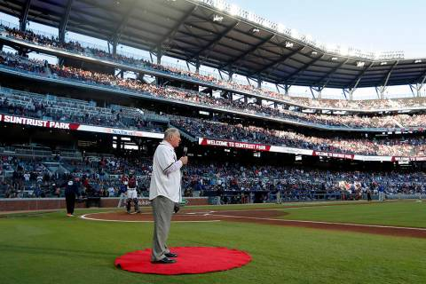 Former Atlanta Braves manager and Baseball Hall of Fame member Bobby Cox gives the command to & ...