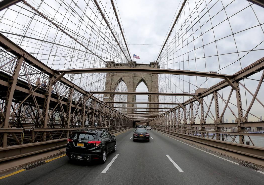Motorists cross over the Brooklyn Bridge heading west into Manhattan, Friday, March 29, 2019, i ...