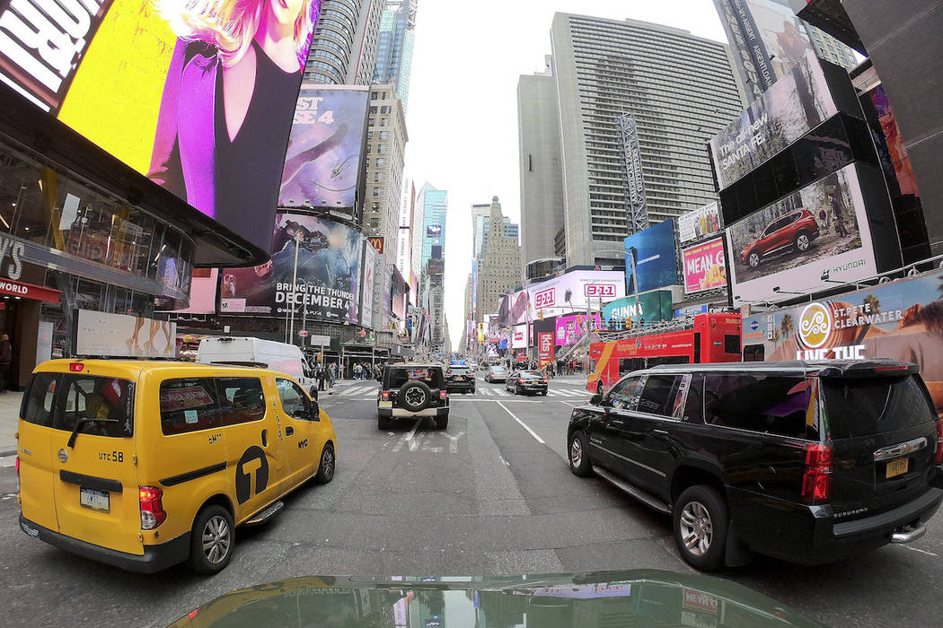 Motorists roll south on 7th Avenue in Times Square, Friday, March 29, 2019, in New York. A cong ...