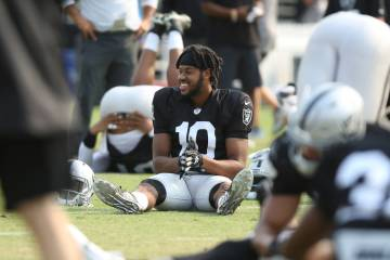 Oakland Raiders wide receiver Seth Roberts (10) warms up at the team's NFL training camp in Nap ...