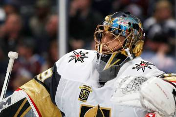 Vegas Golden Knights goaltender Marc-Andre Fleury leans on the top of the net during a time out ...