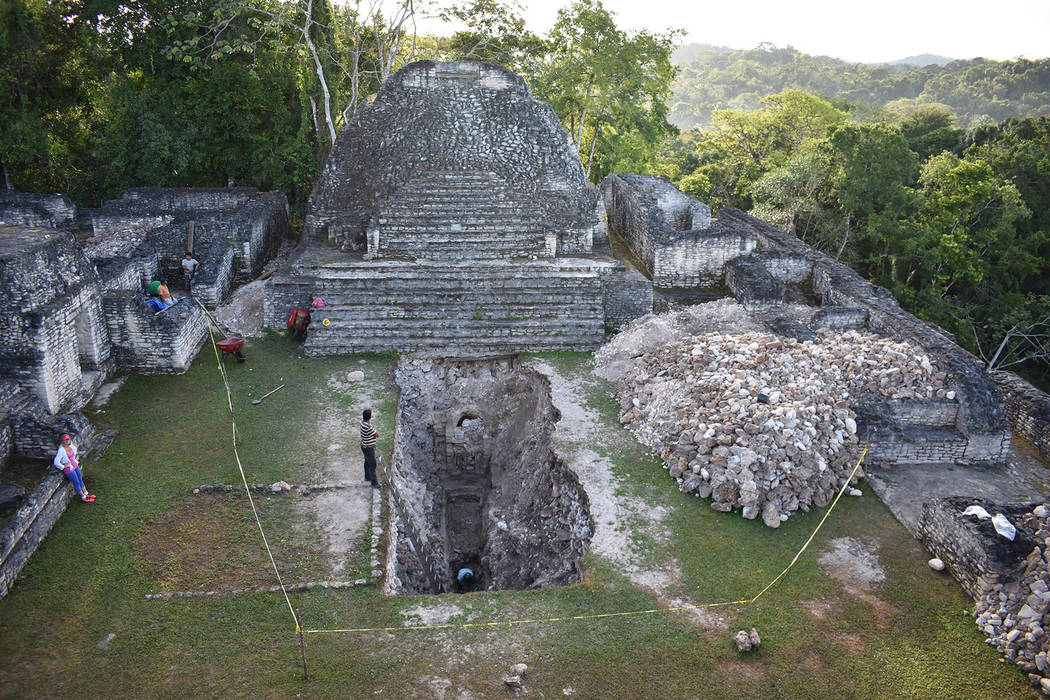 Researchers work at the Maya ruin site of Caracol in Belize in 2017. (Arlen and Diane Chase)