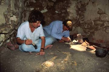 Diane and Arlen Chase excavate the floor of a tomb at the Maya ruin site of Caracol in Belize d ...