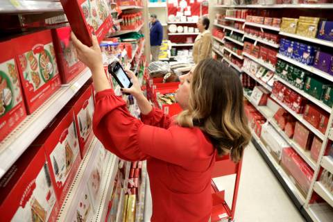 In this Nov. 16, 2018, file photo Target employee Lindsay Walker scans an item as she collects ...