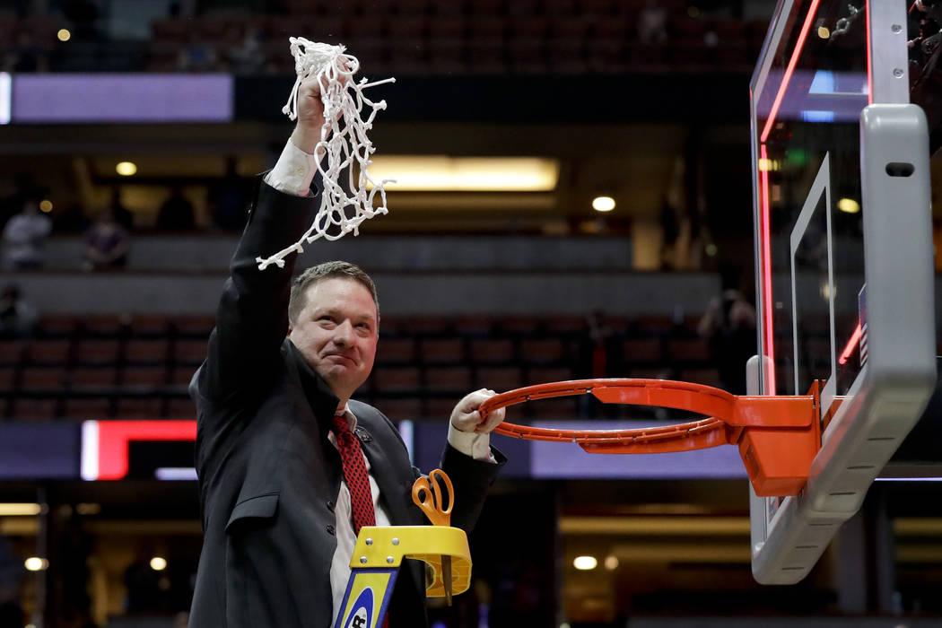 Texas Tech coach Chris Beard holds up the net after the team's win over Gonzaga in the West Reg ...