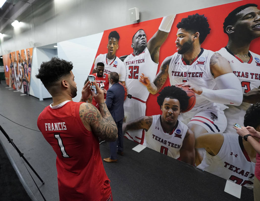 Texas Tech's Brandone Francis takes a picture of his picture after a practice session for the s ...