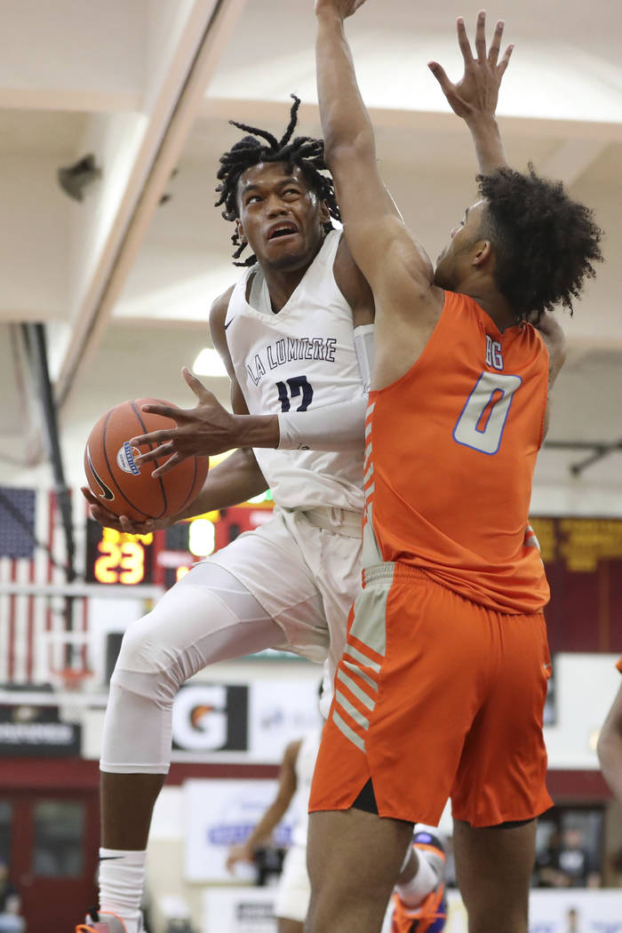 La Lumiere's Keion Brooks #12 in action against Bishop Gorman's Isaiah Cottrell (0) in a Boys Q ...