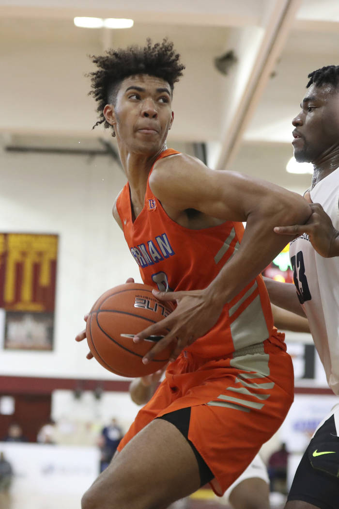 Bishop Gorman's Isaiah Cottrell (0) handles the ball in the post against La Lumiere's Isaiah St ...