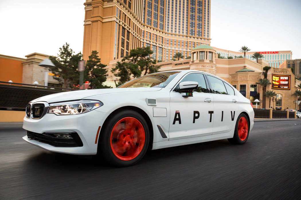 The APTIV vehicle with autonomous technology drives on the strip Friday, Dec. 1, 2017, in Las V ...