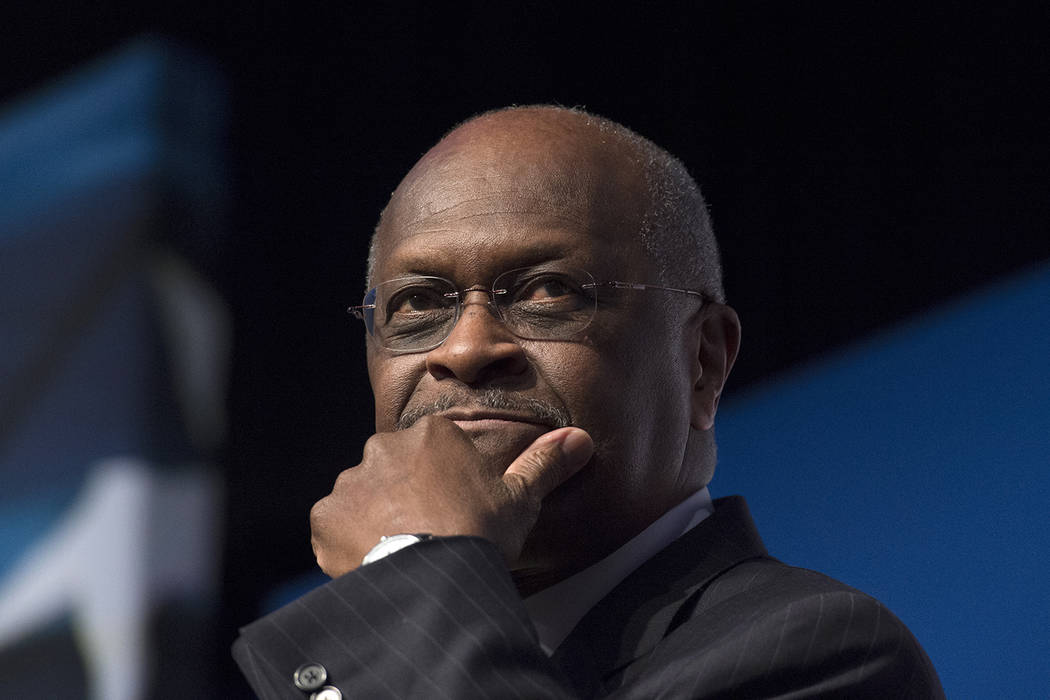 Herman Cain speaks during Faith and Freedom Coalition's Road to Majority event in Washington, F ...