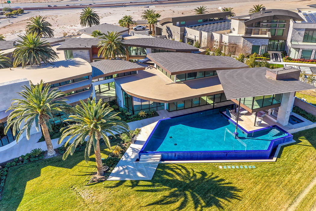 Las Vegas developer Jim Rhodes' 20,000-square-foot Spanish Hills home is listed for nearly $30 ...