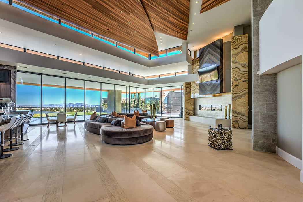 The home has a lot of floor-to-ceiling windows to capture the sweeping views of the Strip. (Ber ...