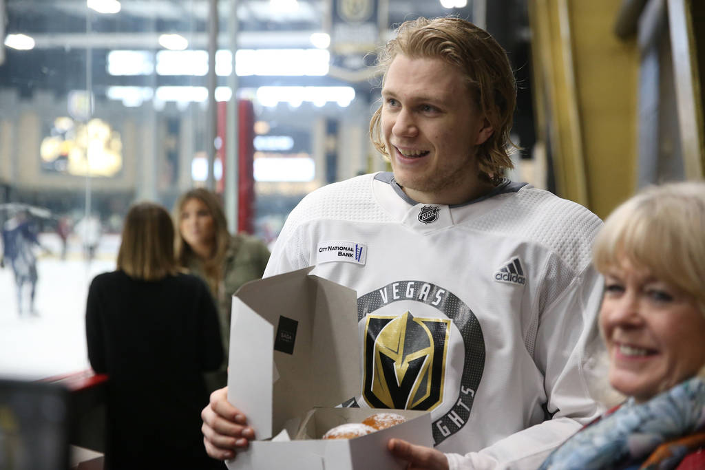 Vegas Golden Knights center William Karlsson (71) receives Swedish pastries made on Fat Tuesday ...