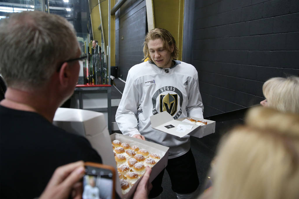 Vegas Golden Knights center William Karlsson (71) is presented with Swedish pastries made on Fa ...