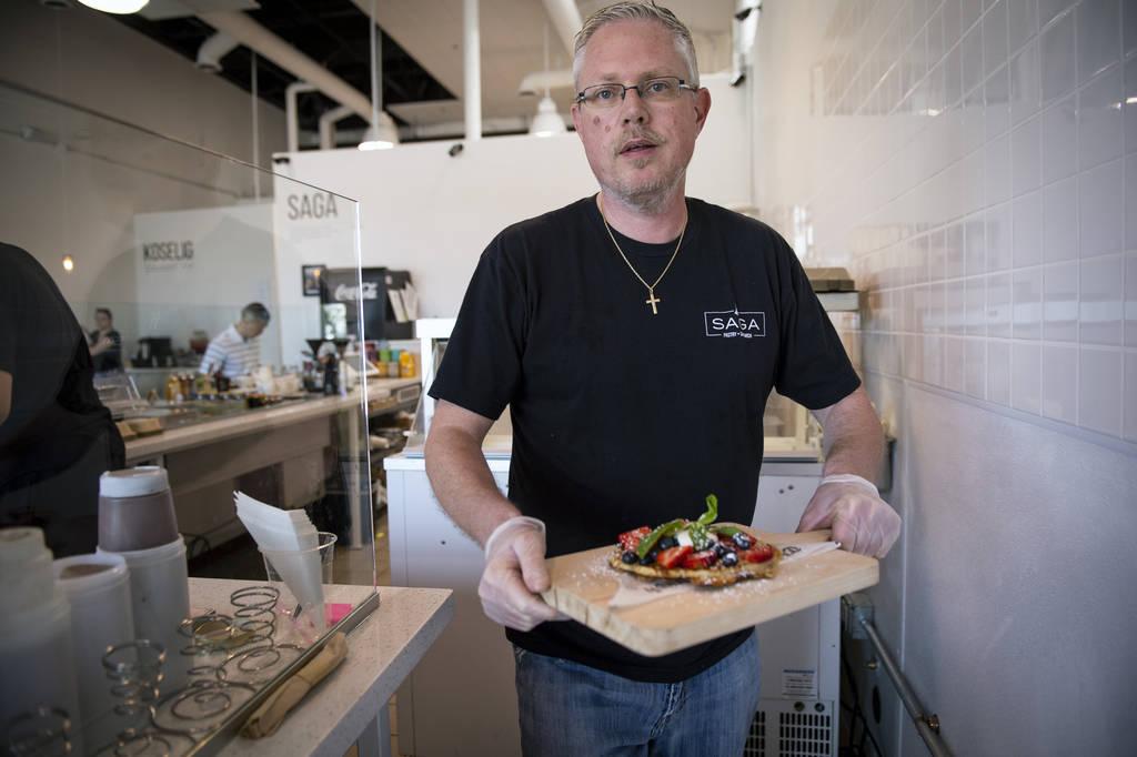 Owner Gert Kvalsund serves a nordic waffle at Saga Pastry + Sandwich in Las Vegas, Sunday, Apri ...