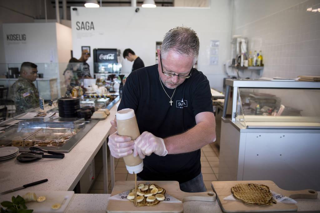 Owner Gert Kvalsund makes a nordic waffle at Saga Pastry + Sandwich in Las Vegas, Sunday, April ...