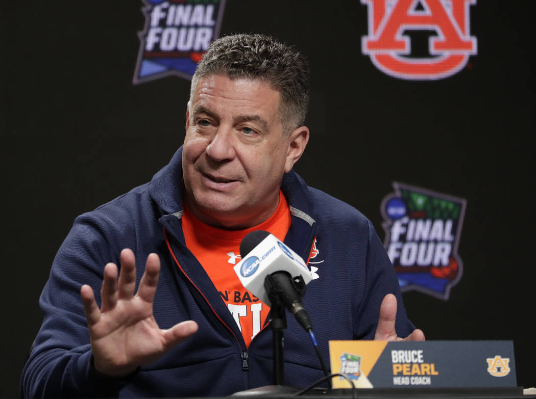 Auburn head coach Bruce Pearl answers questions after a practice session for the semifinals of ...