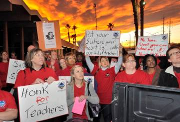 Clark County Education Association supporters listen to CCEA union president Ruben Murillo duri ...
